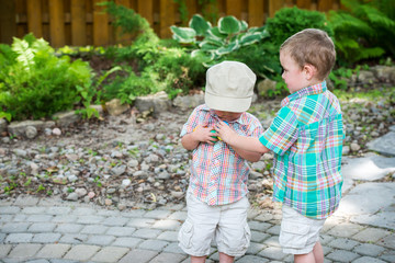 Two Boys Collect Colorful Easter Eggs