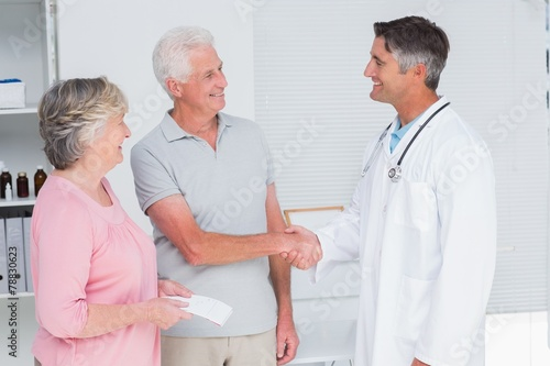 Senior couple visiting doctor - 78830623