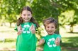 canvas print picture - Happy siblings in green with thumbs up
