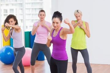 Women boxing at fitness studio