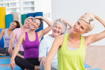 Women doing neck exercise at fitness club