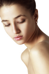 Beautiful Face of Young Woman. Clean Fresh Skin. Isolated on Whi