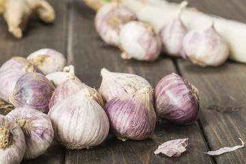 purple garlic on the wooden board