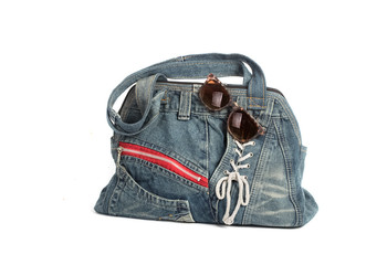 Blue jeans women bag with sun glass isolated on white background