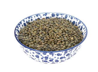 Marbled dark green lentils in a blue and white china bowl