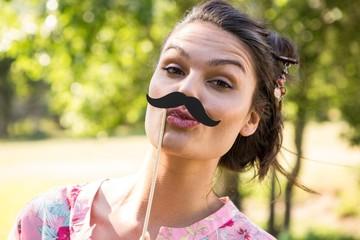 Pretty brunette with fake mustache