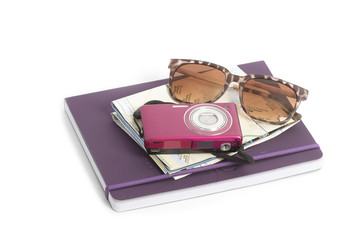 Travel plan road map ,camera and sun glass  on a note book