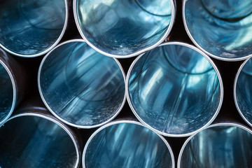Abstract industrial background, empty blue metal tubes