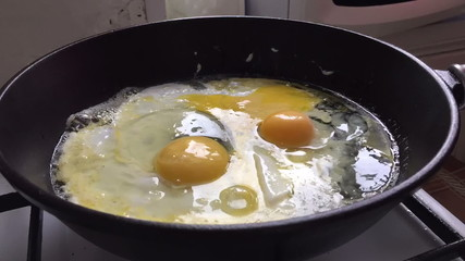 cooking eggs and bacon