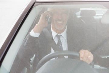 Smiling man sitting at the wheel