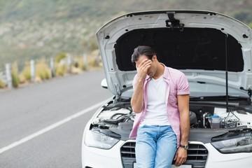 Desperate man after a car breakdown