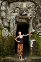 Young woman standing at Goa Gajah