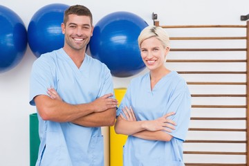 Team of therapists with arms crossed smiling at camera