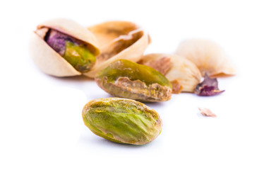 Toasted pistachios on a white background