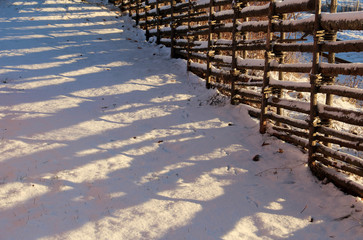Old Swedish wooden fence in winter