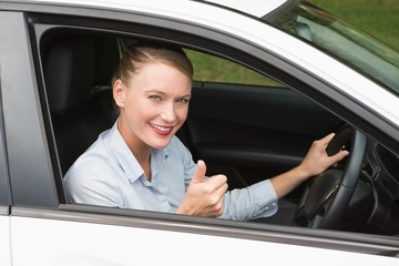 Smiling businesswoman sitting in drivers seat