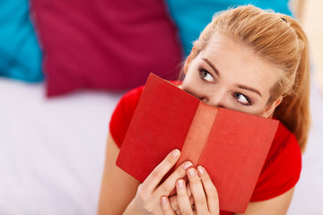 Pretty blond woman reading a book
