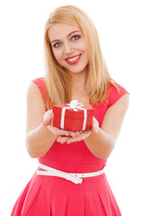 Young beautiful woman opening a gift box