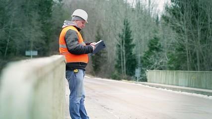 Engineer reading documentation on the bridge