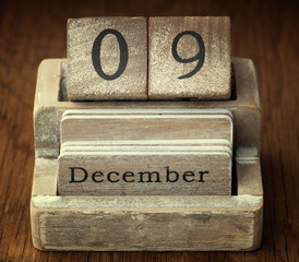 A very old wooden vintage calendar showing the date of 9th Decem
