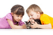 two children playing with kitten