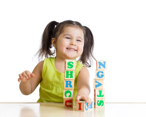 elementary school student playing letter blocks