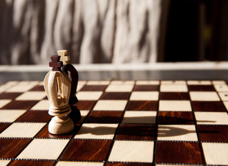 king chess piece with others in background