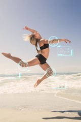 Composite image of fit blonde jumping gracefully on the beach