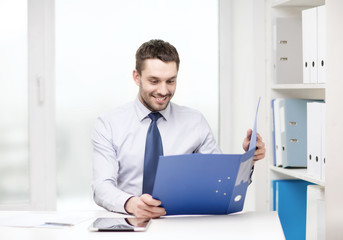 businessman with folder and tablet pc computer