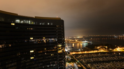 Time Lapse of Building and Marina at Night San Diego