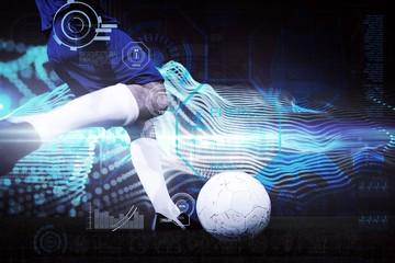 Composite image of football player kicking ball