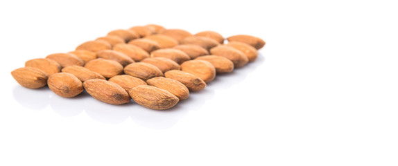 Raw almond nut over white background