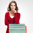 Beautiful woman in red casual clothing with shopping bags, on gr