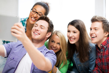 students taking selfie with tablet pc at school