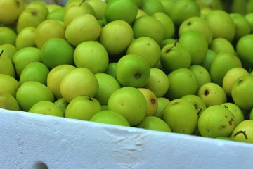 Fresh green apple on the table in the market.
