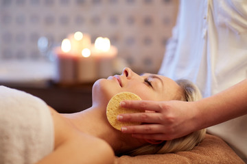 close up of woman having face massage in spa
