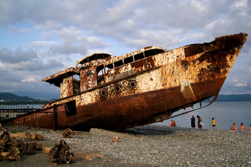 Abandoned rusty ship on the sea