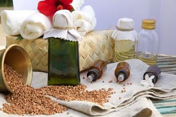A glass bottle of buckwheat oil on a sackcloth