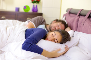 Couple in love sleeping peacefully