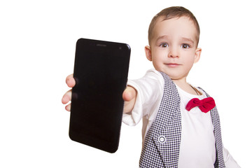 stylish little boy in checkered suit and bow tie shows a mobile