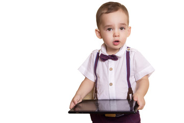 stylish little boy in checkered suit and bow tie with a tablet