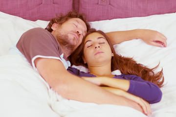 Couple sleeping in bed peacefully