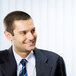 Portrait of cheerful smiling young businessman at office