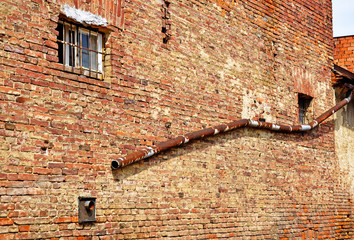 Brick wall of an old ruined building