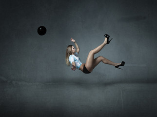 football player in a bicycle kick