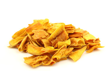 colorful pieces of dried mango fruit on a white background
