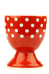 colorful and decorated red and white egg cup on a white backgrou