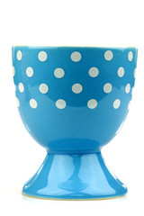 colorful and decorated blue and white egg cup on a white backgro