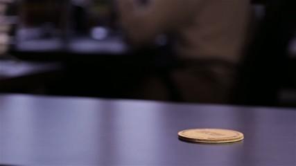 man's hand puts a black mug on black table