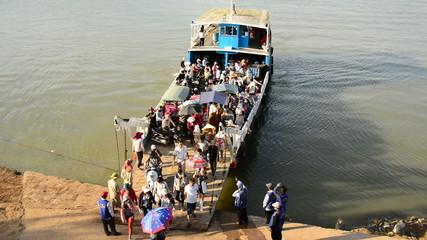 Ferry Unloading Passengers on the Dock in Phnom Penh Cambodia